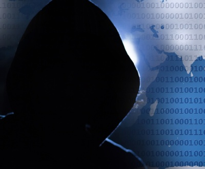 Mysterious hacker in hoodie; represents problem solved by proper IT solutions for security